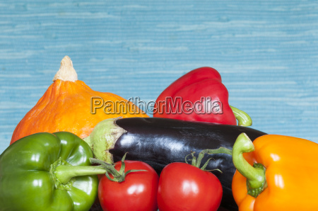 vegetables against blue background