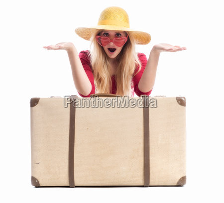 astonished woman with suitcase