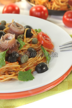spaghetti alla puttanesca with olives capers