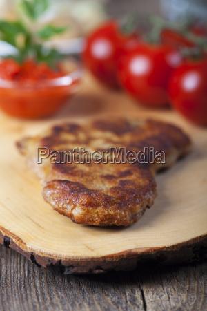 wiener schnitzel on a wooden board