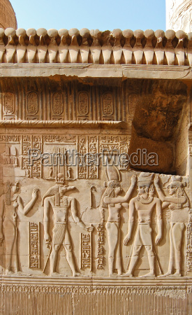 egyptian engraved gods on wall in