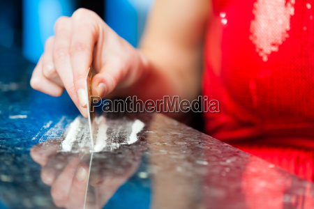 young woman sniffs cocaine