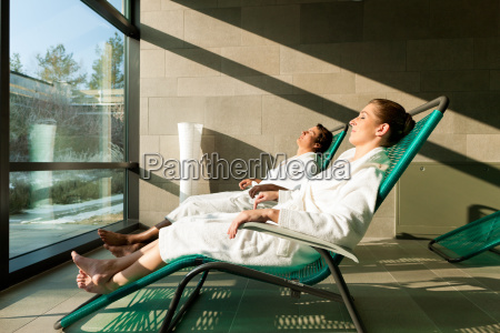 young couple relaxing in wellness spa
