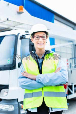 crane driver in front of crane