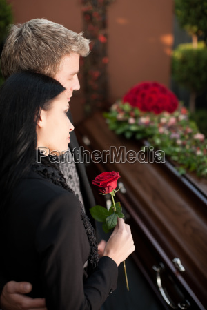 people on burial with coffin