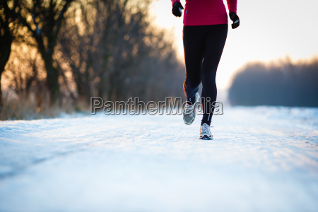 winter running young woman running