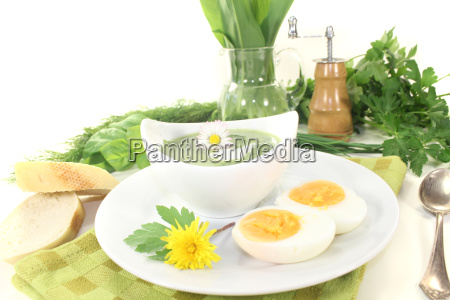 green herb soup with daisies