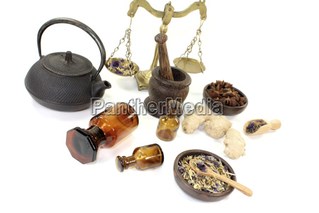 chinese medicine with mortar and scales