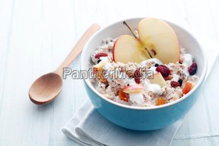 bowl of muesli apple fruit nuts