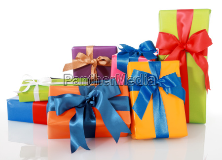 assorted colored presents with ribbons on