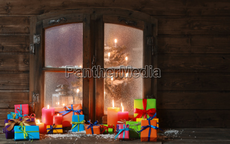 gift boxes and candles at window