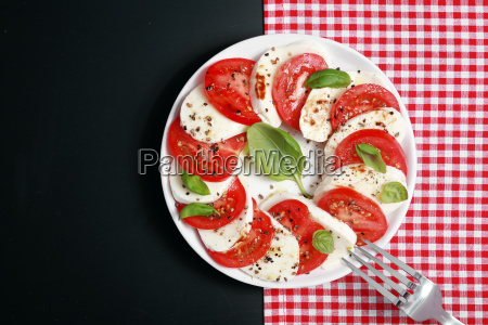 italian caprese salad with mozzarella and