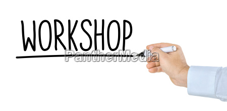 hand with pen writes workshop