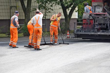 workers laid asphalt