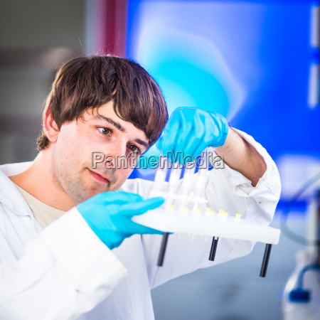 young male researcher carrying out scientific