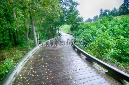 a wooden golf cart pathway bridge
