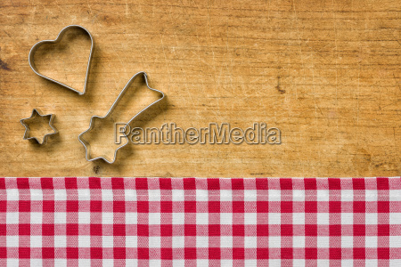 wood background with christmas cookie cutters