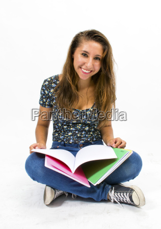 girl student with colorful notebooks in