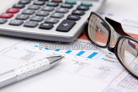 stock chart with calculator pen and