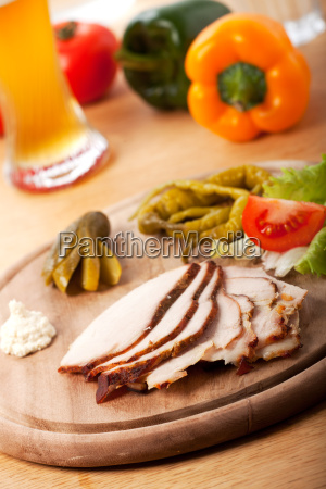 cold boiled pork on a wooden
