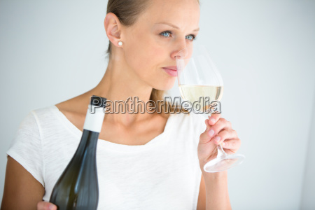 gorgeous young woman with a glass