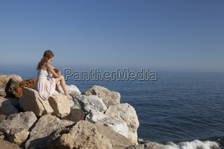 at the sea young woman sitting