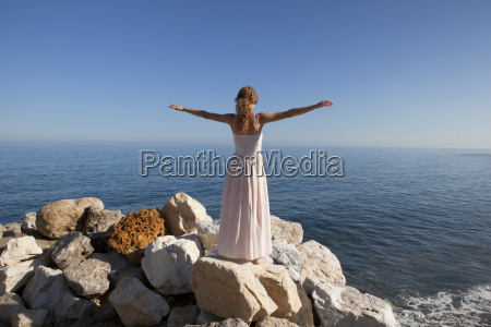 young woman at the sea standing