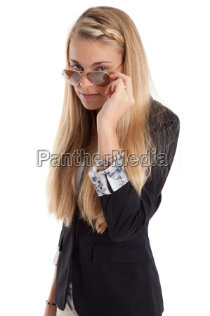 woman looks over the glasses of