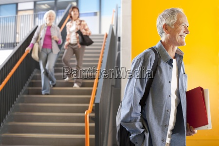 adult students in college arriving for
