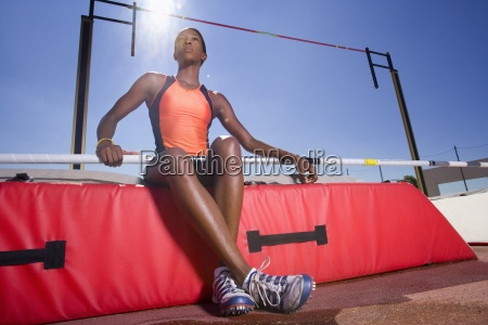 female pole vault athlete low angle