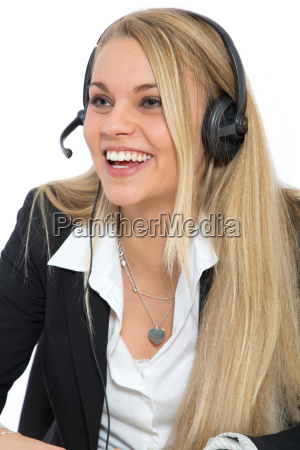smiling woman with headset on head