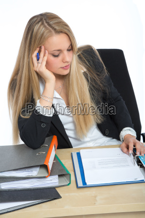 woman looking in her documents