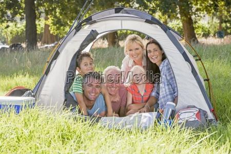 multi generation family enjoying camping trip