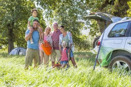 multi generation family unpacking car on