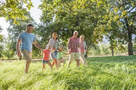 multi generation family enjoying walk in