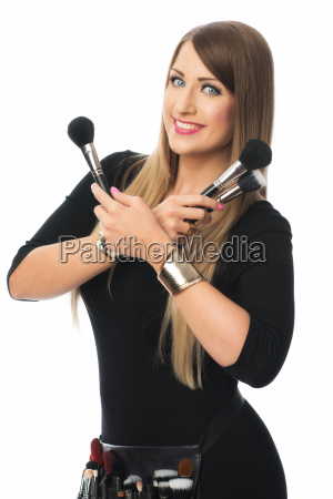 visagist with cosmetics brush