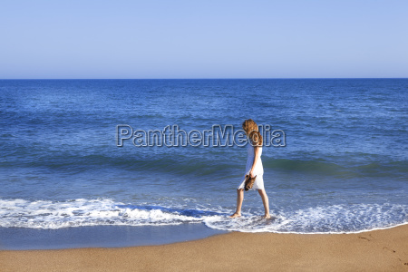 holidaymaker with feet in wate