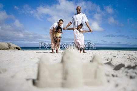 sandcastle on beach focus on two