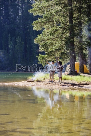 couple in mid distance fishing near