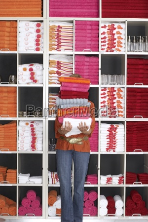 woman shopping in department store holding