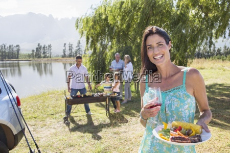 multi generation family enjoying barbeque by