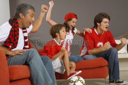 family watching a sports match on
