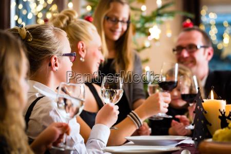 family celebrating christmas while eating potato