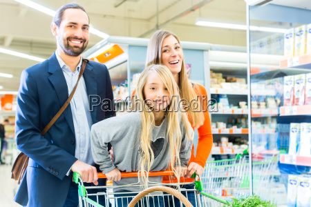 family with shopping trolley in a