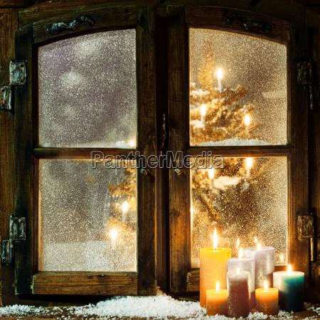 welcoming christmas window in a log