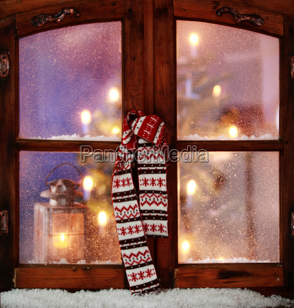 christmas scarf hanging on window pane
