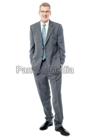 confident businessman keeping his hands in