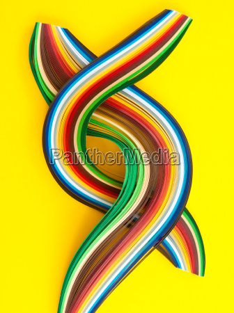 colorful paper stripes on yellow