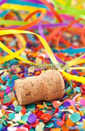 champagne cork on confetti