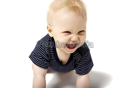 cute baby laughing first tooth